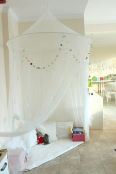 fairy tale reading fort with DIY paint chip star garland - fun for kids!
