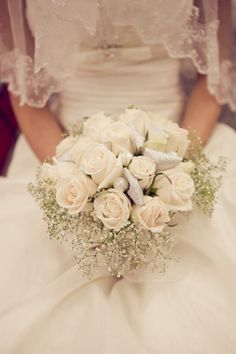 My 1950s wedding: Baby's breath or Queen Anne's lace is a great touch around the outside of a bouquet!
