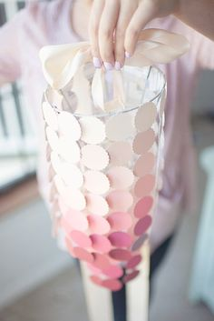 Paint Chip Chandelier: Punch out pretty shapes in your paint chips and string them together to make a very pretty ombré chandelier.  Source: Hey Gorgeous