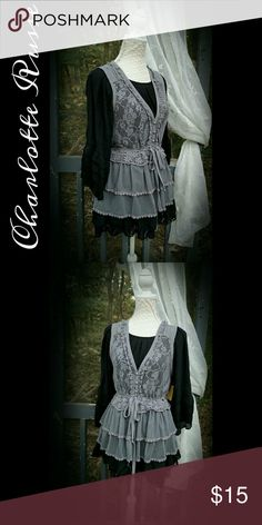 "🌵PERIWINKLE LACE VEST ✨SIZE: L ✨BRAND: Charlotte Russe ✨MEASUREMENTS: B-40"" W-35""  L-25"" ✨DESCRIPTION: VEST ONLY. Vintage look lace vest.  Multiple lace textures. Ties at waist. ✨COLORS: Periwinkle Gray  🌹 BLACK TUNIC NOT INCLUDED🌹               (used to show lace) Charlotte Russe Jackets & Coats Vests"
