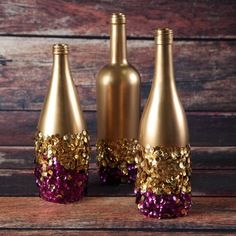 Gold sprayed bottles with gorgeous sparkly sequins