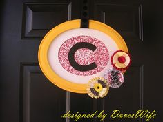 Love this happy, fun, nontraditional wreath...check it out at the Diary of DavesWife: {Wreath} Tutorial