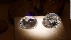 Cubic zirconia replicas of the original and a modern cut of the Kohinoor diamond.