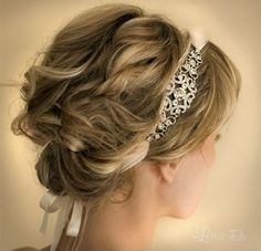 Classical Greek-inspired updo with crystal and silk band