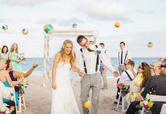 Mini beach balls?! Awesome! 18 Creative Exit Toss Ideas   The Knot Blog – Wedding Dresses, Shoes, & Hairstyle News & Ideas