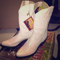 Boots Black and white cowboy boots, women's size 8.5, fits a little bigger then that. Brand new, never worn! Originally bought for a Dallas cowboy cheerleader costume but never ended up wearing it! :/ Durango Shoes
