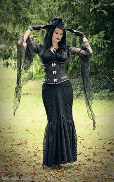 Have a witchy evening!! Shot for The Gothic Shop. Wearing brands - Dark in love / Gothlolibeauty, Burleska Corsets, Sinister. Hat by Killstar. Pendant by Kalithea Alternative Accessories.