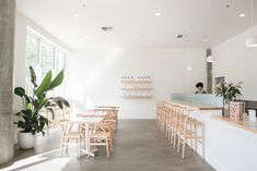 Dining Room, Table, Bar, Chair, Stools, Concrete Floor, Pendant Lighting, and Recessed Lighting For Tea Bar, Swanson chose lighting from local outfit Schoolhouse Electric, including the Isaac Pendent. Photo 5 of 15 in 10 Best-Designed Places to Eat and Drink in Portland, Oregon