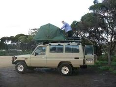 Toyota Landcruiser Troopcarrier with roof sleeping tent.