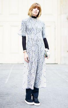Sheer dress worn over a turtleneck, pants, and platform sneakers