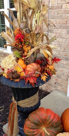 41 Cozy Thanksgiving Porch Décor Ideas | DigsDigs NOTE: Use this idea by front door using gray pots; put dowel in middle and add corn stalk etc. Like the ribbon also
