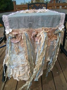 Handmade romantic shabby-chic table runner. Faded, weathered French blue fabric makes up the base of this runner, with hand-dyed tattered lace,doilies, muslin, cheesecloth and little white flowers. Lovely!