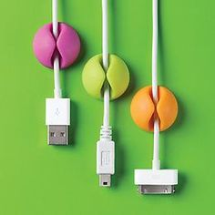 Self-adhesive cable cords to stick on desk.