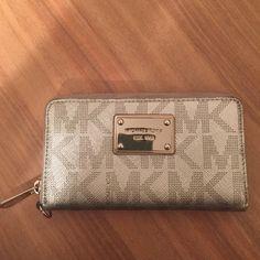 Michael Kors Wallet Silver zip-around wallet with light scratches on plaque Michael Kors Accessories