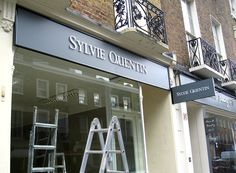 Sylvie Quentin jewellery shop sign - raised acrylic letters on aluminium framed sign with projection sign.