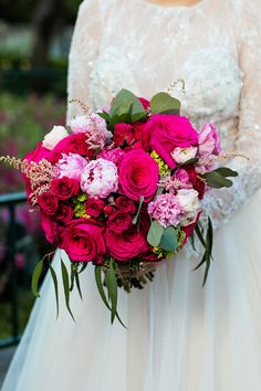 Vibrant shades of pink and red for this Disneyland bride's bouquet