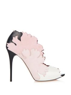 £441.00 Falling in step with the theme of Alexander McQueens ready-to-wear collection these pink suede and white leather Kimono Flower shoes evoke a Japanese spirit. They comprise flower-shaped cut-out panels and a black leather stiletto heel. The open front silhouette instantly lengthens legs.