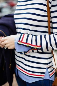 Classic navy stripe with grosgrain trim detail and button sleeve.