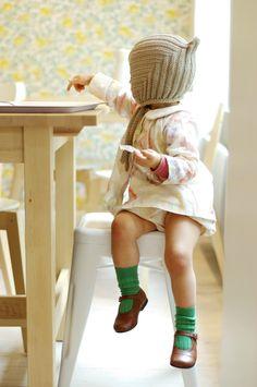 Lovely bonnet, little green socks and like the shoes