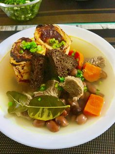 Baked marrow bones and clear beef soup with lemon touch. Yammy !