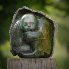 Verdite stone sculpture titled 'Boy Hiding' by Zimbabwean stone artist Sylvester Mubayi