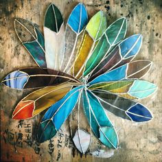 Gorgeous hand crafted stained glass feathers. I'm smitten.