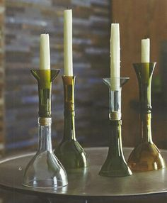 Set of two Recycled Wine Bottle Candle Holders. One short one tall. No two are alike. Hand made.  Wonder if I can make these.