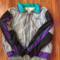 Givenchy mens windbreaker jacket Fun Retro colors highlighted with purple, silver, and aqua blue. Elastic bottom with fashion zipper and button fold over for extra warmth. Has been used but still plenty of vintage style and life left to it!!! Fits M-L and could be worn as unisex Givenchy Jackets & Coats
