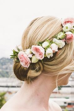Low bun and a fresh flower crown: http://www.stylemepretty.com/2014/10/16/contemporary-portland-ballroom-wedding/ | Photography: Christy Cassano-Meyer - http://christycassanomeyer.com/