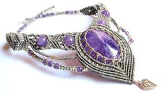 A great one of a kind gift!!!  A unique and very elegant micro macrame necklace with a stunning amethyst semi precious cabochon (its inside pattern looks like the most amazing lightning you ever seen), amethyst beads and genuine hill tribe silver components (from Thailand).  Intricate knots wrap the amethyst stone without glue or wire to create a pattern that stands out. It sits perfectly around the neck, following the collar bone's natural structure , highlighting the area and making it and…
