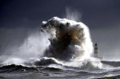 Waves swallow a lighthouse. #Awesomeness