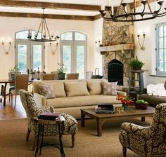 Love the sconces on the walls, traditional seating, neutral scheme