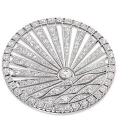 *Art Deco Circular Diamond-Set Sunrise Brooch,An Art Deco diamond brooch, the circular plaque depicting a stylised rising sun over water, the lower section of undulating form with an old brilliant-cut diamond 'sun' above, within an openwork radiating frame, to an outer scalloped border, white millegrain set throughout with single, old and old-brilliant-cut diamonds, estimated total diamond content 3 carats, brooch pin fitting to the reverse, circa 1925