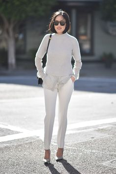 fall / winter - street style - street chic style - fall outfits - casual outfits - business casual - office wear - work outfits - neutral layers - neutral outfits - all white - ivory short sleeve sweater + ivory shirt + ivory ankle pants + white heels + grey sunglasses + black shoulder bag