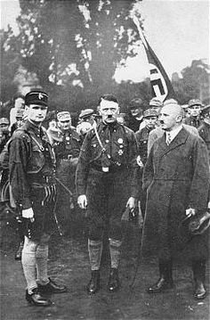 Adolf Hitler, Rudolf Hess (left), and Julius Streicher (right) outside at the third Nazi Party Congress in Nuremberg. (August 19-21, 1927)
