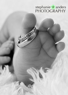 I like the idea of a child with his/her parent's wedding rings.