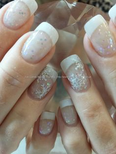 White acrylic tips with glitter acrylic and freehand snowflake Christmas nail art