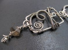 Silver wire-wrapped pendant with smoky quartz by Jane of Lone Rock Jewelry