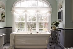 In a Rumson, New Jersey, bathroom designed by Laura Kirar, a Waterworks Empire tub is framed by a seven-foot-wide arched window. Bad Inspiration, Bathroom Inspiration, Home Design, Dining Room Wainscoting, Wainscoting Height, Black Wainscoting, Wainscoting Stairs, Painted Wainscoting, Wainscoting Ideas