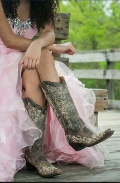 Rockin her cowgirl boots with her prom dress