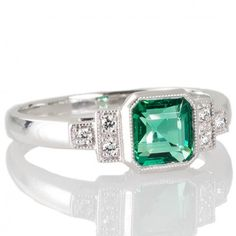 09061d177bbbac Octagonal Zambian Emerald & Diamond Ring. Browse our collection of antique,  Art Deco, and modern jewellery at www.rutherford.com.au