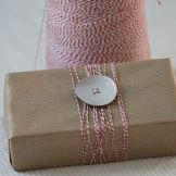 button with bakers twine and brown paper