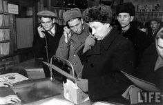 Russians listening to records (Edward Clark. 1955).