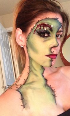 Zombie Halloween makeup. Love the bloody eyebrow with safety pins. Could be great for a Wife of Frankenstein costume, too.