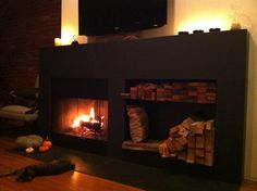 Warmth - Reclaimed chalk boards made into my fireplace.