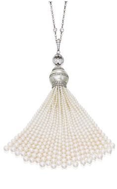 PLATINUM, CULTURED PEARL AND DIAMOND SAUTOIR Centering a cultured pearl measuring approximately 16.5 mm, suspending a tassel composed of numerous cultured pearls measuring approximately 5.2 to 1.7 mm, the necklace further decorated with seed pearls, set with round and rose-cut diamonds.