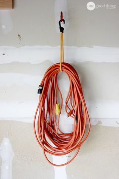 Garage Organization - bungee cords and bicycle hooks and lots of other good ideas.