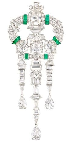 An Art Deco Platinum, Diamond and Emerald Brooch, circa 1925. The openwork brooch with top centring one old-mine pear-shaped diamond, central section centring one marquise-shaped diamond, flanked by two pear-shaped diamonds, and suspending three pear-shaped diamonds, set throughout with 116 round and single-cut diamonds, and 31 rectangular-cut, baguette and fancy-shaped diamonds. From the Collection of Irving Gold. #ArtDeco #brooch