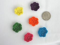 Tiny crocheted flowers using embroidery thread.  Free pattern