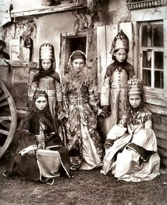 A group of Abaza women in traditional festive costumes. From the Kuban region, late 19th century. The Abazins (or Abaza) are an ethnic group of the Caucasus, closely related to the Abkhaz and Circassian (Adyghe) people.